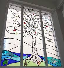 Stainglass window designs Simple Stained Glass Tree And Seascape Elle Decor Designs In Glass Stained Glass Windows And Lead Lights