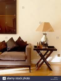 Next Living Room Silver Lamp With Beige Shade On Dark Wood Side Table Next To Beige