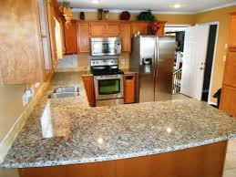 venetian ice granite on um colored wood traditional kitchen