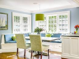 custom zinc table and a sunny corner banquette create a great gathering spot for the entire