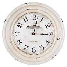 circular iron wall clock in distressed white frame