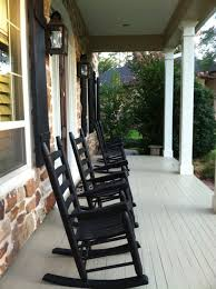 black painted oak wood outdoor rocking chairs which mixed with white laminate wooden floor front