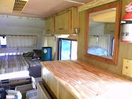 new plywood counter tops and wall paneling complete the renovation of the motorhome