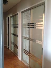 used blue tape and frosted spray to create more modern design on mirror closet doors in admirable design mirrored closet door