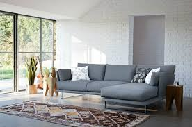 l shape furniture. L Shaped Grey Corner Modern Couches With Floral Pillows Two Wooden Tables Decorative Plant On Patterned Rug Shape Furniture