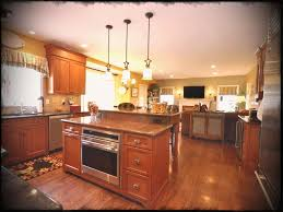 oven in island. Kitchen Attractive Family Design With Oven Island And Antique Hanging Lamp Plus Marble Countertop In N