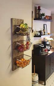use reclaimed wood and baskets to create the wall storage of fresh produce