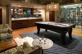 pool table rug chic basement with armchairs face to face across a brown leather bench with