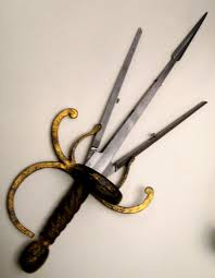 sharp weapons. left hand dagger with spring blades that can be opened by pressing a button, c. 1620. sharp weapons w