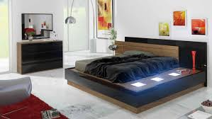 Black And Walnut Bedroom Set With Ambient Blue Lighting - Black and walnut bedroom furniture