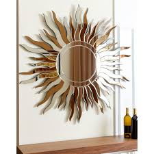 Hang this artistic wall mirror in the space of your choice to add a touch  of class with it's Sol desert design and circular frame. The sun rays are a  ...