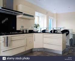 Small Fitted Kitchen Cream Fitted Units In Modern Cream Kitchen With Small Breakfast