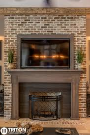 reclaimed brick fireplace also provided reclaimed beams mantel and tv enclosure