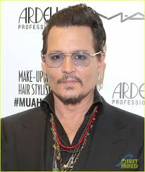 johnny depp presents award at makeup artist hair stylist guild awards 2016