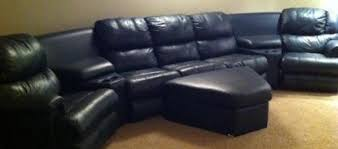 like new navy blue leather sectional with 2 recliners