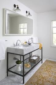 white walls a luxurious marble double sink and an area rug give this