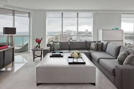 this modern living room naturally lit via floor to ceiling windows features immense white
