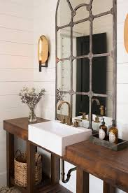 reclaimed bathroom furniture. rustic powder room with wooden washstand made of reclaimed oak shiplap walls and brass sconces palmetto cabinet studio bathroom furniture