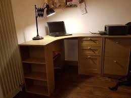 large curved corner desk with 4 shelves and 3 drawers