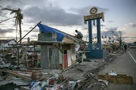 photographic essay sink or swim designing for a sea of change tacloban 20 2013 a man hammers away amidst the destruction caused