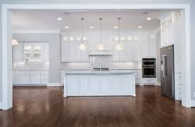 Center island lighting Cream Colored Kitchen Gorgeous All White Kitchen With Large Center Island Love The Cabinet Lighting And The Glamorous Island Pendantu2026 Greenville Maxwell Farm Drive Home Pinterest Gorgeous All White Kitchen With Large Center Island Love The