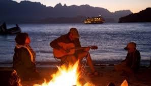 playing guitar beach ile ilgili görsel sonucu