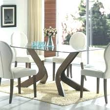 swinging round dining table set for 4 mar ebony 5 and chair sets uk