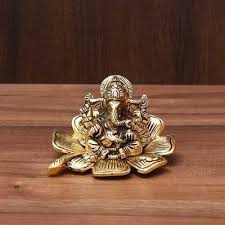 white metal ganesha in flower with gold finish indian return gift
