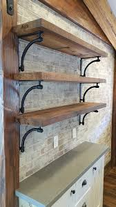 open shelves with cast iron brackets on newly installed brick wall a fresh look for our renovation project