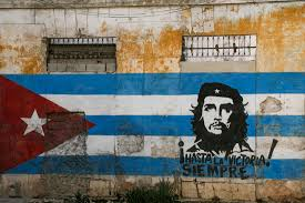 havana a photo essay a faded orange building has the n flag painted along its entire length che