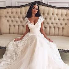 romantic wedding dresses v neck cap sleeve lace over skirt split