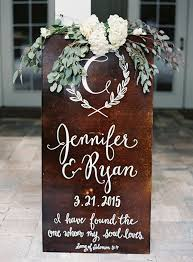 rustic wooden wedding signs with white and green fl decorations