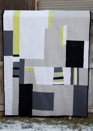 from the blue chair: My quilt back is featured on Modern Day Quilts & I came across this site when she featured Val's amazing owl quilt from Pink  Please. Modern Day Quilts just posts one great modern quilt each day. Adamdwight.com