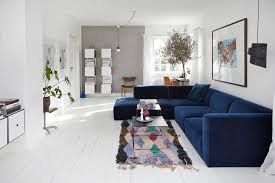 wiltshire grey accent wall living room scandinavian with blue sectional prints and posters