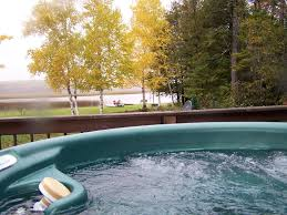 the river s edge w outdoor hot tub canoe paddleboat kayaks on n river cottage rental view from outdoor hot tub