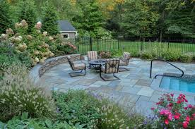 bluestone pool patio with curved seat wall to provide additional seating ringwood nj