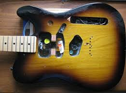 noise reduction for sc pickups telecaster and stratocaster the stripped telecaster before the coil slot is cut a router