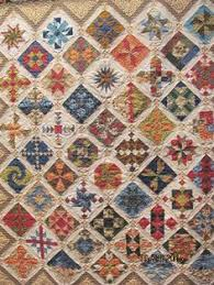 Joan won Best in Show for her Vintage Moments Quilt at the 2009 St ... & Chisholm Trail Quilt Guild Adamdwight.com