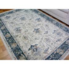persian classical design floor area rugs subdued shades cream blue border allover pattern