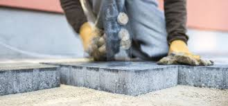 how to level and repair sunken pavers