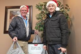 bob left and jeremy right stopped at the milwaukee nari office and made a donation to the nari salvation army toy drive