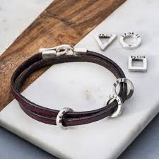 leather and silver men s bracelet with charms