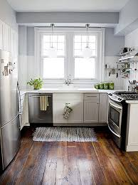 modish small kitchen designs with best white kitchen cabinet set also cool two glass sliding windows also white wall painted and barn wood floors ideas