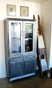 photo of forte studio ca united states vintage metal cabinet with glass doors sliding
