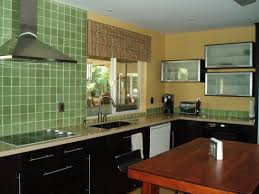 interior cream wall theme connected by green tile backsplash and glass window with striped window
