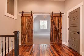 light brown varnished teak double sliding barn door