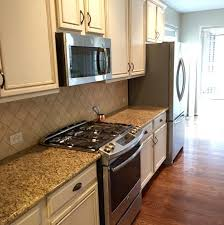 painted brown kitchen cabinets before and after. Repainting-kitchen-cabinets-white Painted Brown Kitchen Cabinets Before And After