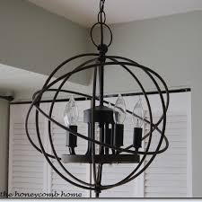 rh chandelier cost 695 00 for the small one my version cost 27 00 i have seen other versions of this orb at marshall s and tj ma