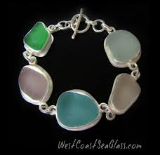 five beautiful sea gl pastels are selected from our pacific ocean collection then set into a fine silver bezel bracelet