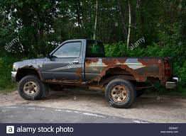 Old rusty junky Toyota pickup truck Stock Photo, Royalty Free ...